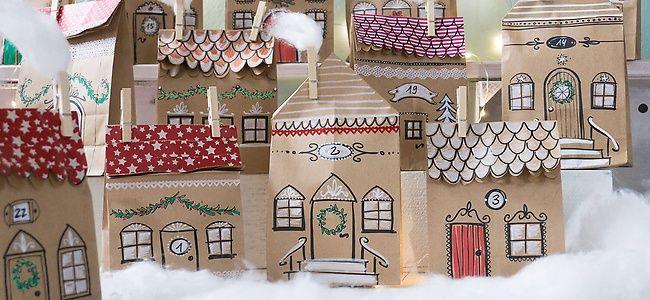 eine m rchenhafte winterstadt entsteht aus einfachen papiert ten eingeschneit wird sie mit. Black Bedroom Furniture Sets. Home Design Ideas