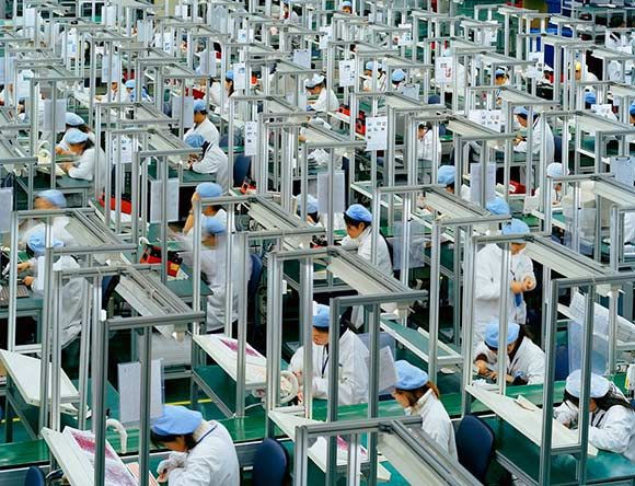 Factory workers in China at Foxconn who work 12+ hour shifts for minimal pay.  Until we all stop buying the crap they make us, this will continue.