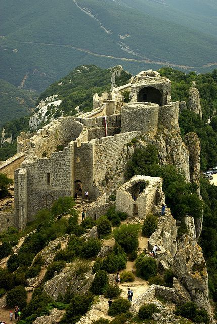 The ruined fortress of Peyrepertuse in Languedoc-Roussillon, France A Cathar Castle & a Royal Castle. Travelling to France soon? Grab a copy of the best French Travel Phrasebook available in the market: https://store.talkinfrench.com/product/french-phrasebook/