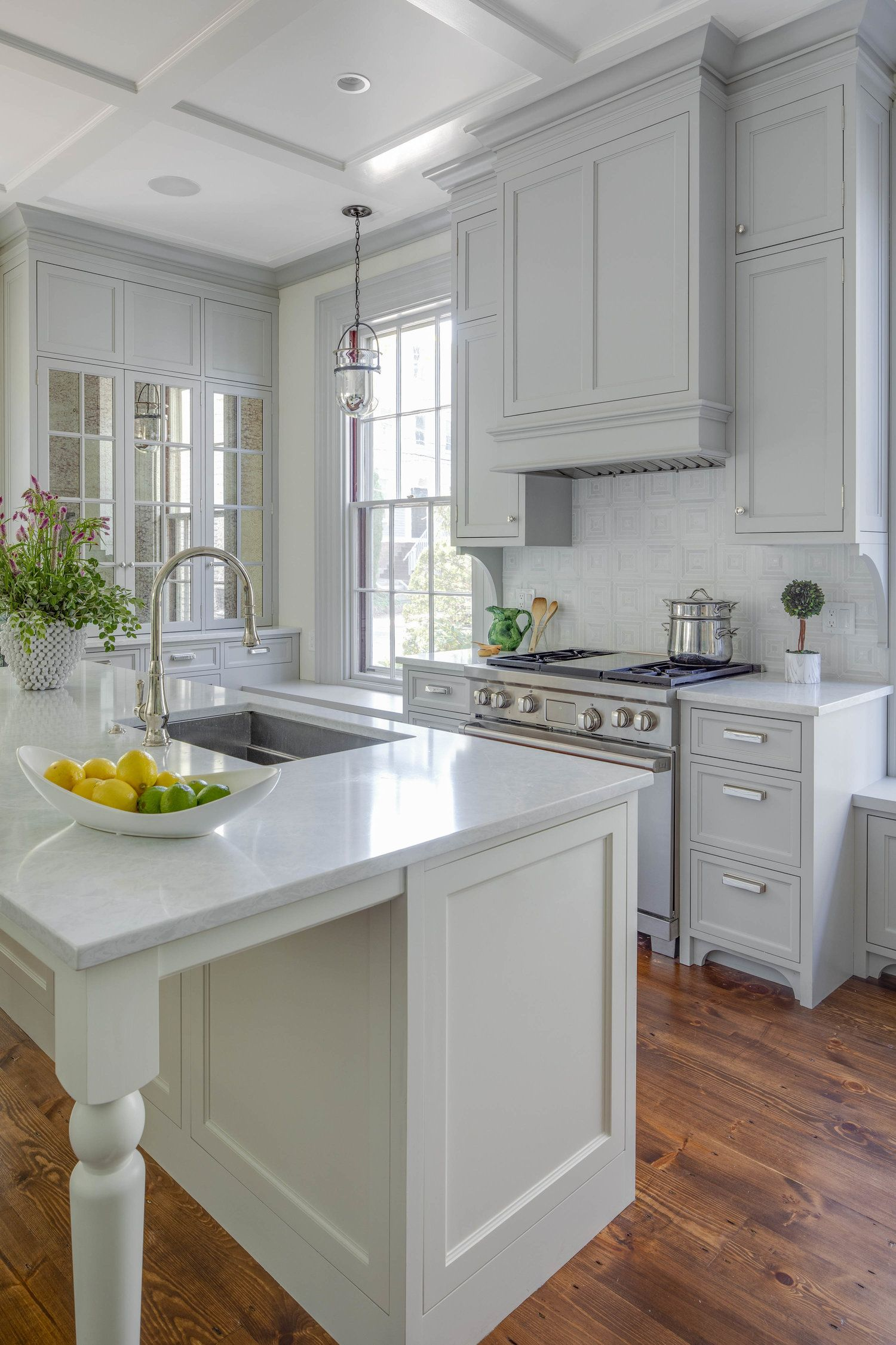 white granite countertops light grey cabinets wood flooring coffered ceiling tradit on kitchen ideas white and grey id=88371