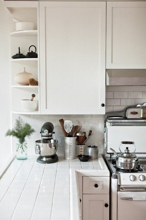 Beau White Tile Countertops Add A Little Bit Of Shine To This Kitchen.