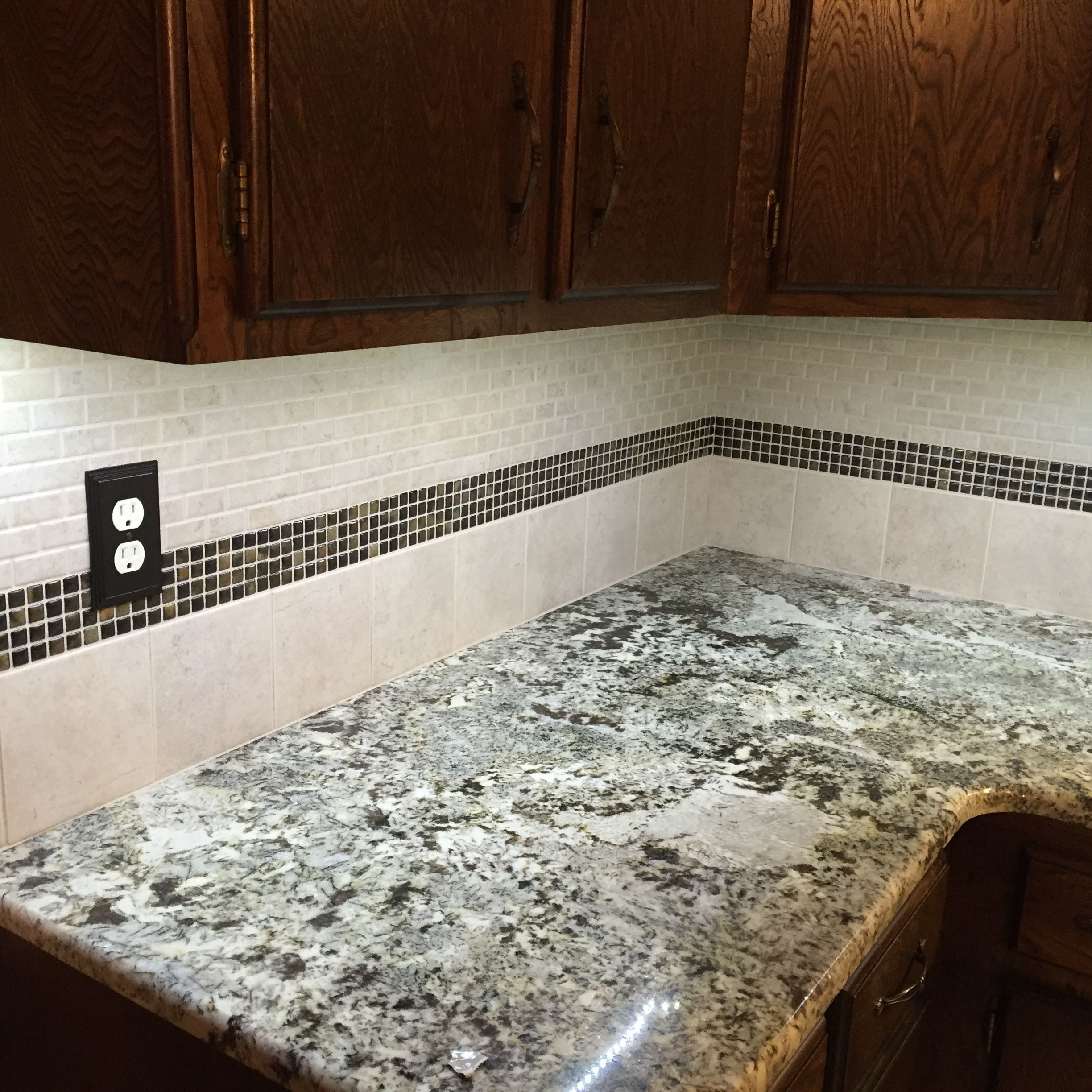 Backsplash Briton Bone mosaic and tile with mosaic strip Umber grout color linen from home Depot Counter is crazy horse granite