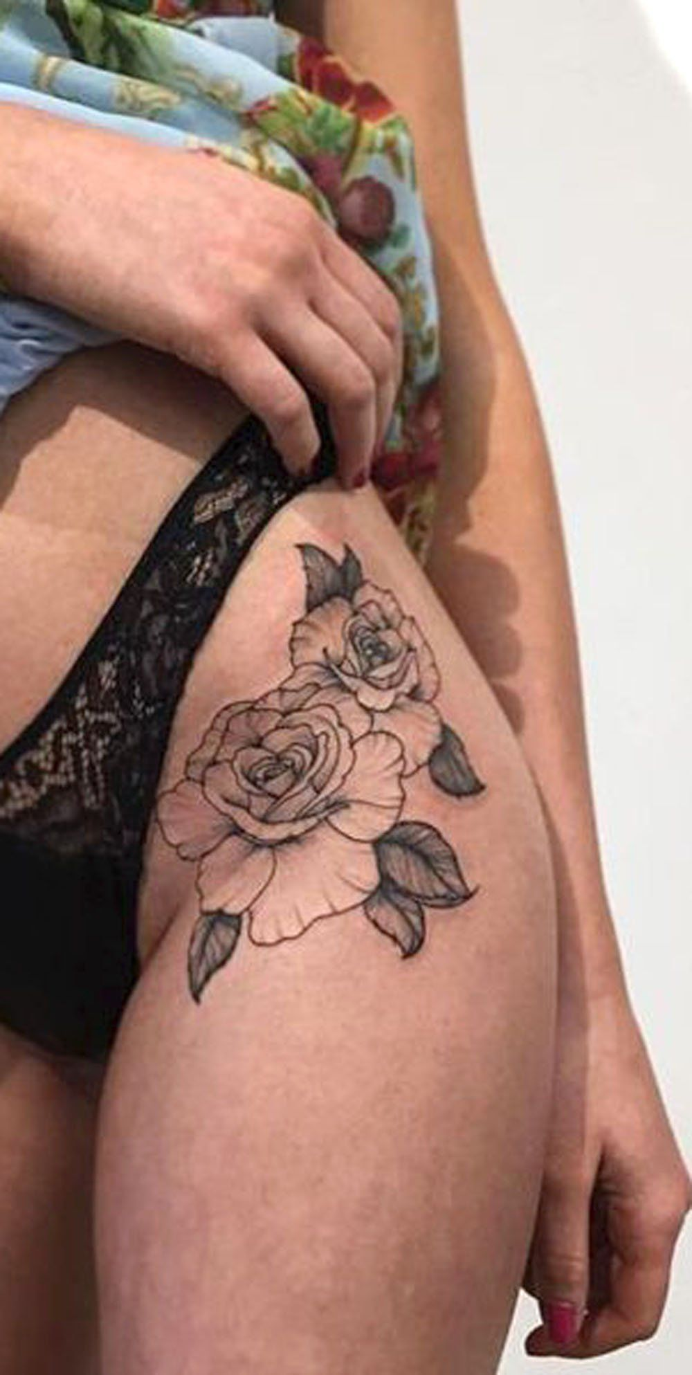 Rose outline tattoo thigh