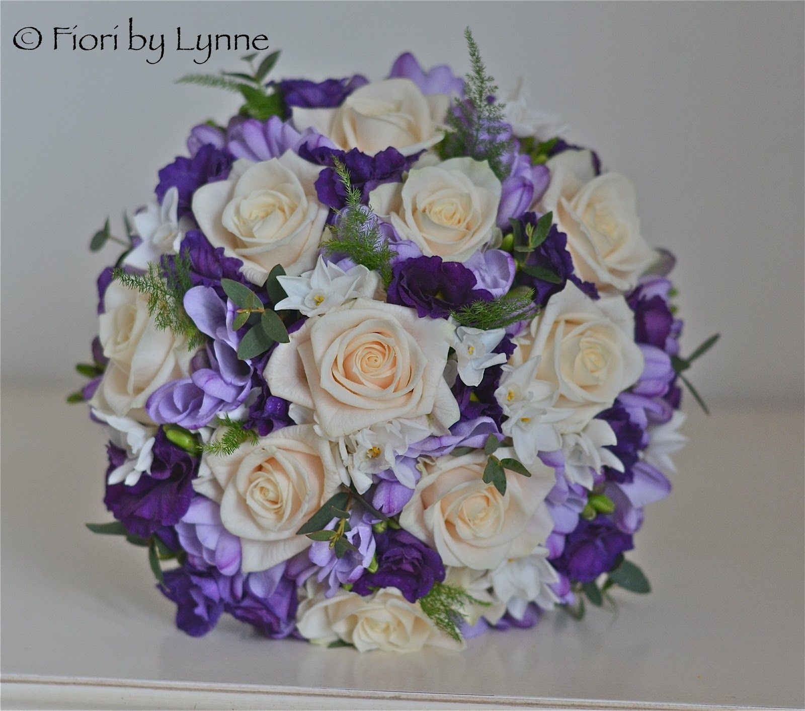 Wedding bouquets in purple lavender blue and champagne bouquet bridal bouquet of purple lisianthus lilac freesias cream roses and paperwhites dhlflorist Choice Image