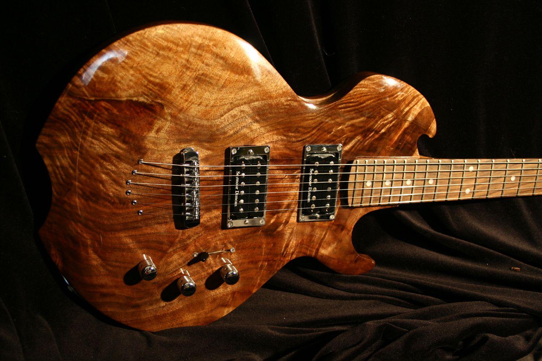 unique guitar custom electric guitars custom bass guitars custom hand made beautiful. Black Bedroom Furniture Sets. Home Design Ideas