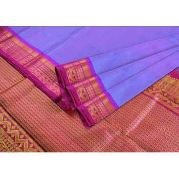 A rare #lavendar colored body with #beautiful #purplish-pink border in thread Zari. Very #traditional motifs in the border make it a #stunner of a #Saree!