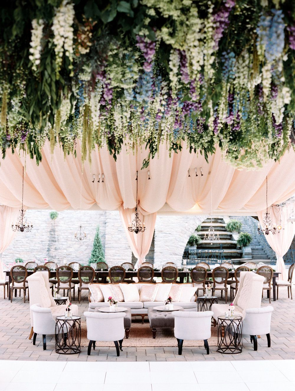 FLORAL CEILING FOR OUTDOOR RECEPTION A floral dreamland of peony, larkspur, rose, hydrangea and astilbe at this rustic and glamorous outdoor wedding at Greenacres Art Center. We created a floral installation layered with over 14,000 blooms that hung from the airy blush reception tent.