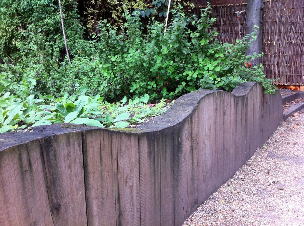 railroad sleeper as retaining wall | Chelsea Garden\'s retaining wall ...