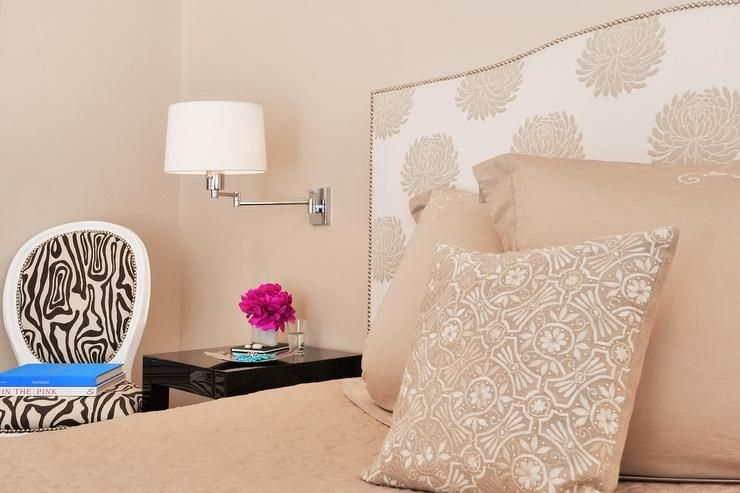 Peach bedroom features walls painted peach lined with a white and ...