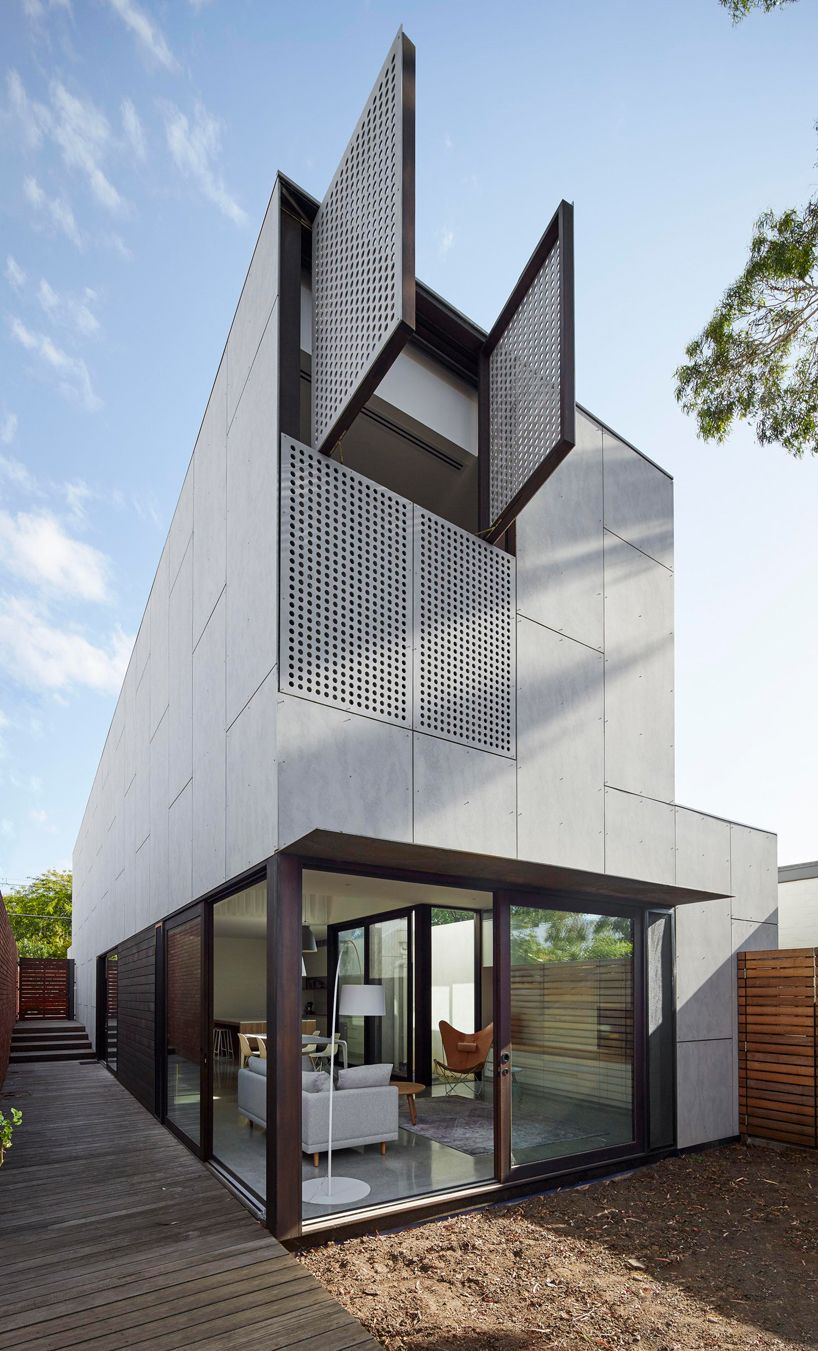 Fibre cement sheet facade flushed with operable perforated metal shutters may grove residence by jackson clements burrows architects melbourne