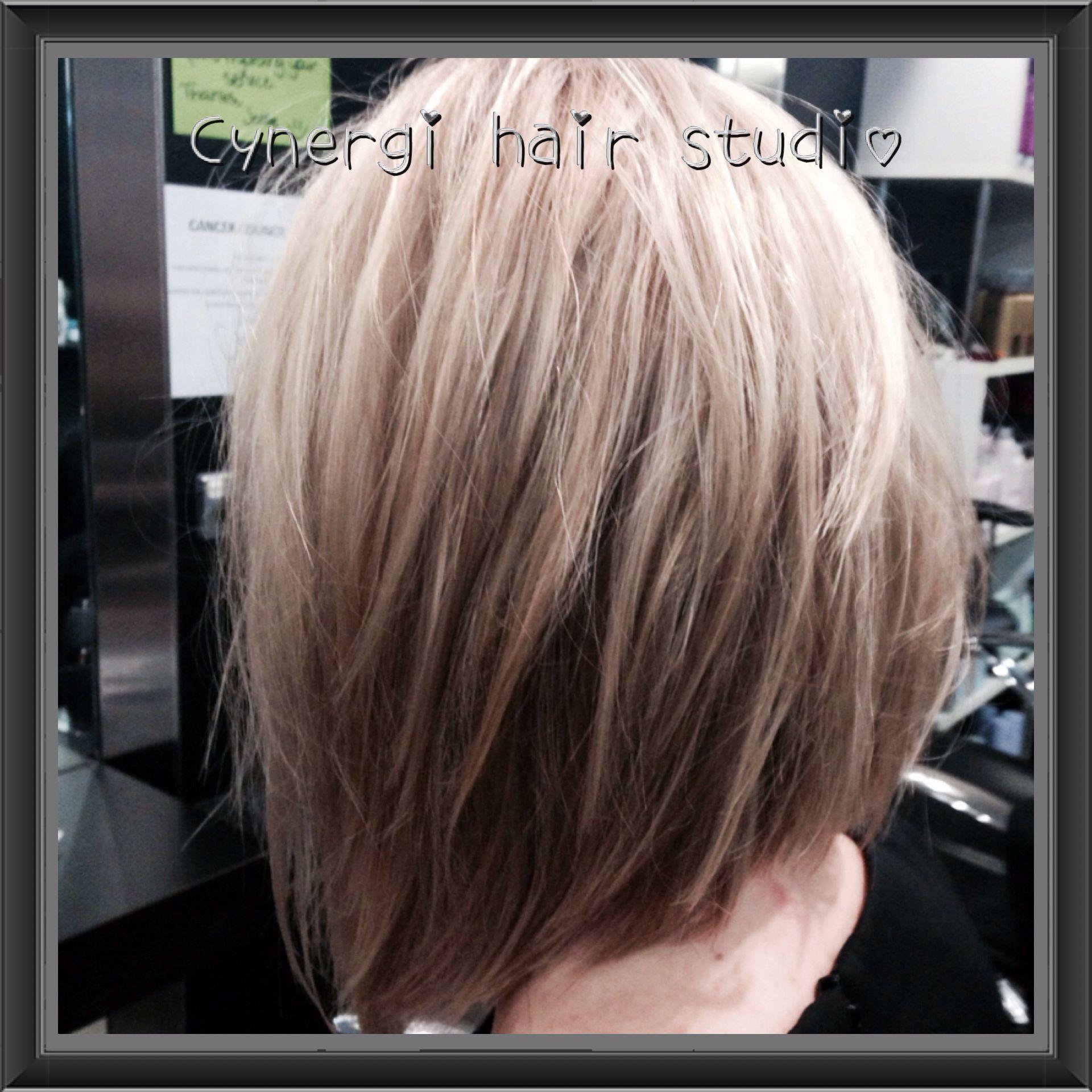 Textured concave bob soft blonde medium length style the lob
