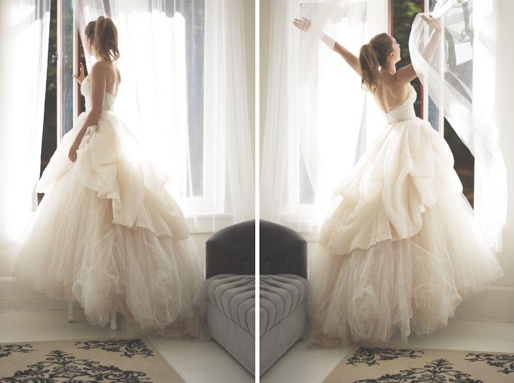 A blush lazaro castillo wedding dress from