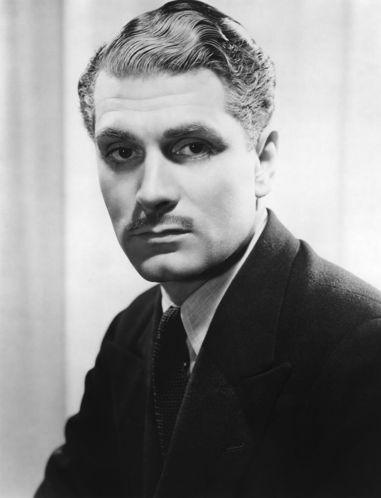 Laurence Olivier, in a publicity still for REBECCA, directed by Alfred Hitchcock (1940)