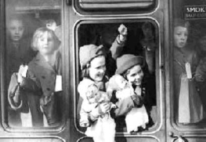 Evacuees on a train out of London, September 1939.  All photographs like this were vetted by the government before they were released.