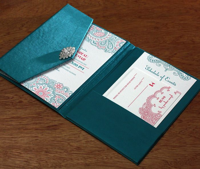 Use a silk folio to display your wedding invitations. These Indian wedding cards are beautiful against the deep blue color here. What wedding colors will you have? Ranjeep | Invitations by Ajalon | www.invitationsbyajalon.com