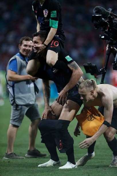 Croatia's midfielder Luka Modric celebrates with Croatia's defender Dejan Lovren after the Russia 2018 World Cup quarterfinal football match between...