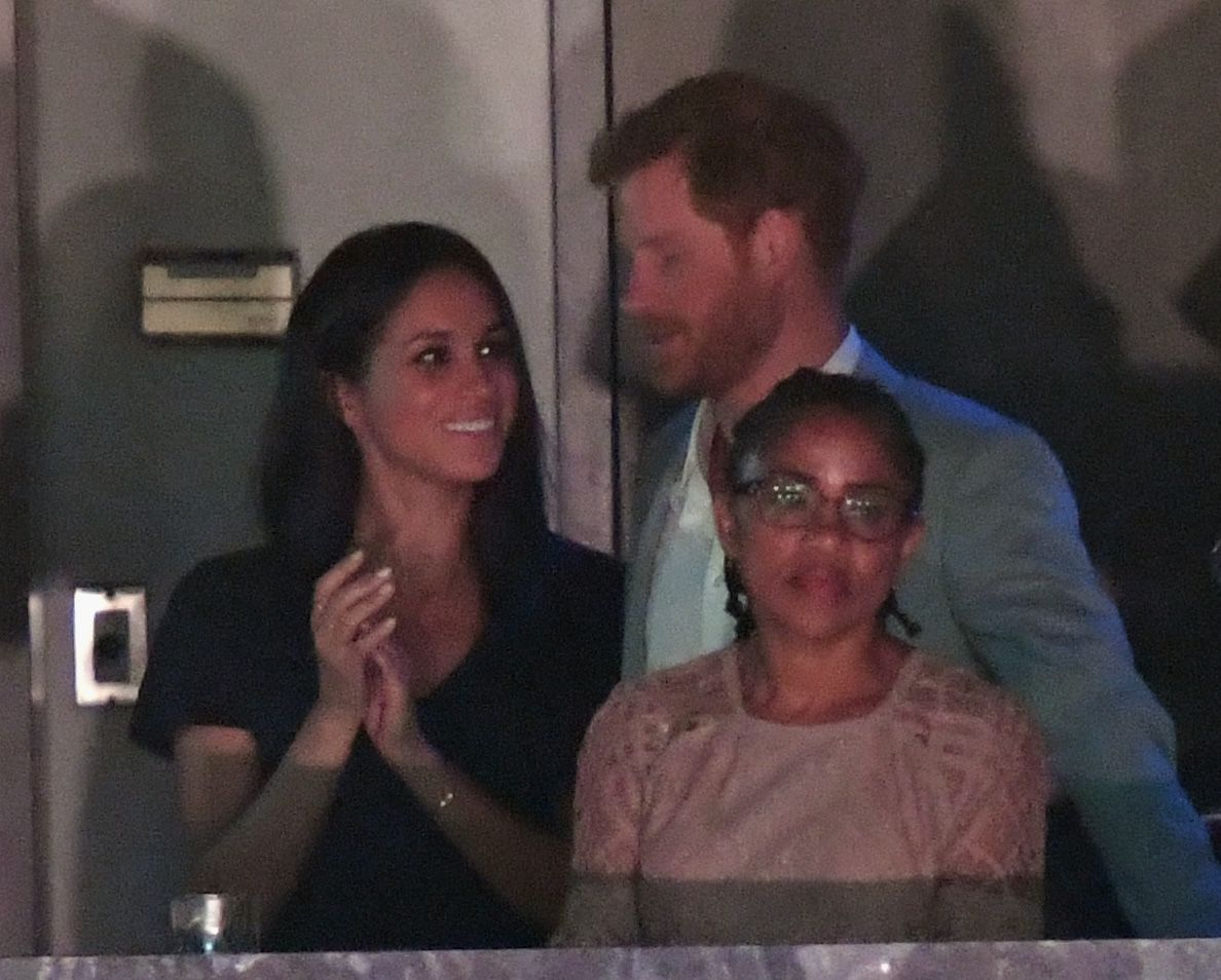 Prince Harry Plants A Kiss On Meghan Markle At Invictus Games