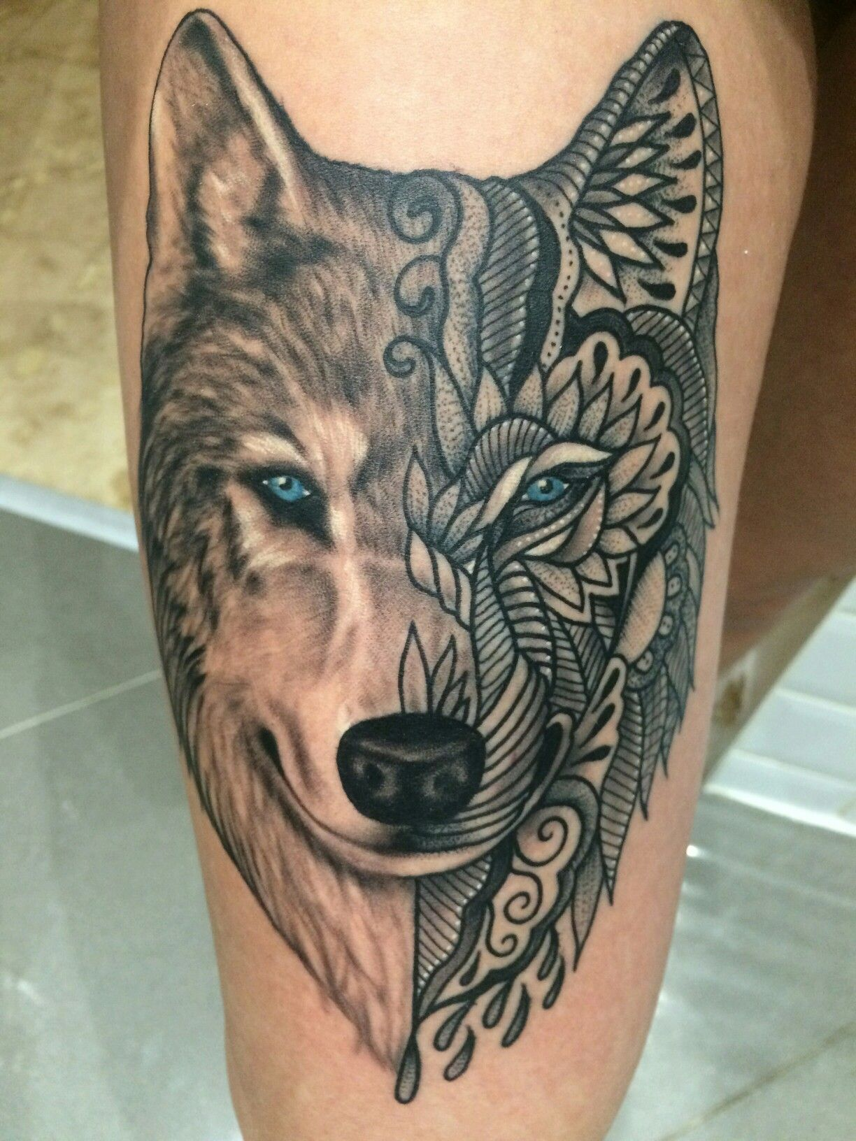 Mandala Wolf Half Realistic Looking Wolf Thigh Tattoo Wolf With Blue Eyes Shoulder Tattoos For Females Small Chest Tattoos Mandala Wolf