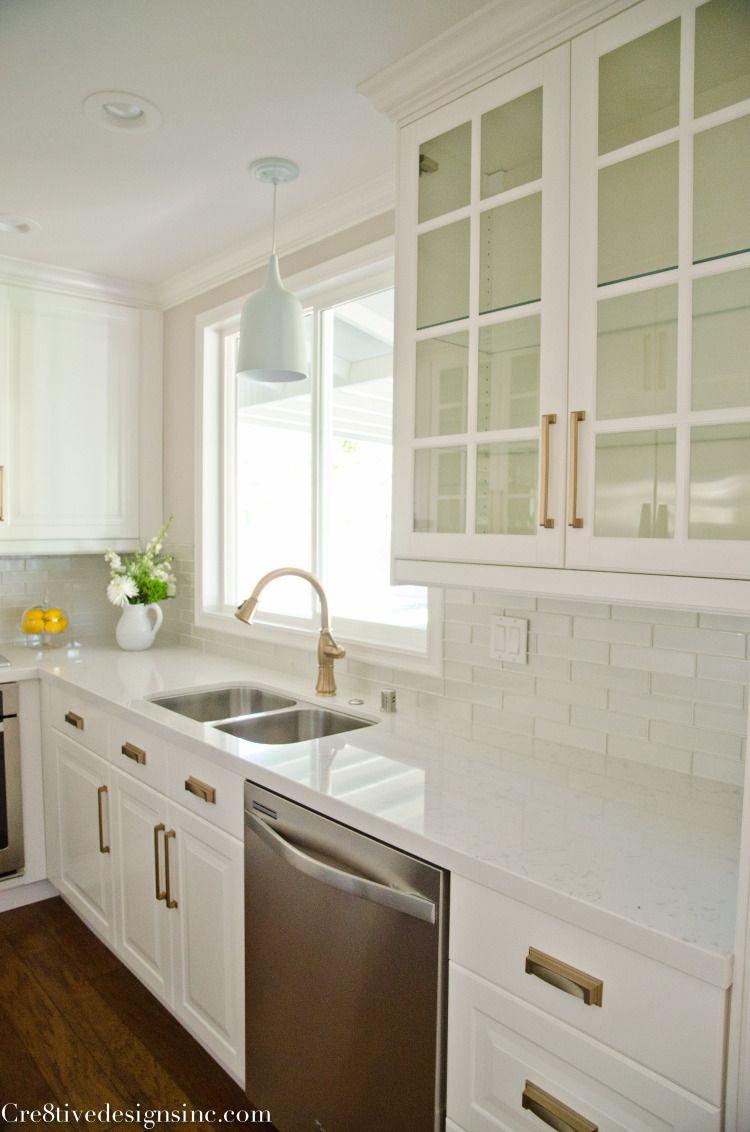 Kitchen remodel using ikea cabinets counter tops are white quartz