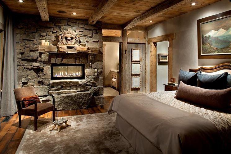 camera da letto rustica con parete in pietra | <-:home sweet home ...