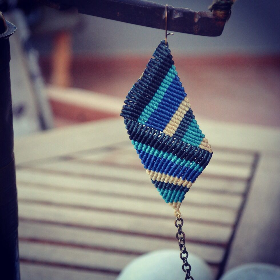 Macrame geometric earring in electric blue, turquoise, grey, black and beige, with a bronze chain