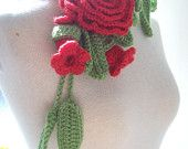 Crochet lariat with green leaves and red  flowers  with a flower brooch