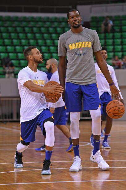 1a548bbfc Stephen Curry and Kevin Durant of the Golden State Warriors talk during  practice and media availability at Shenzhen Gymnasium as part of 2017 NBA.