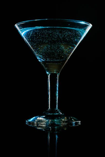 glass shined with colored light on a black background