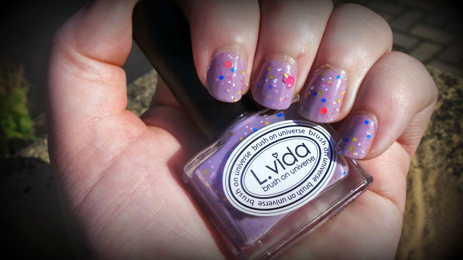 L Vida Korean Brand Nail Polish In Sweet Dream Lilac With Pink Hearts And Different Sized Multi Coloured Glitter Nail Polish Korean Nails Nails