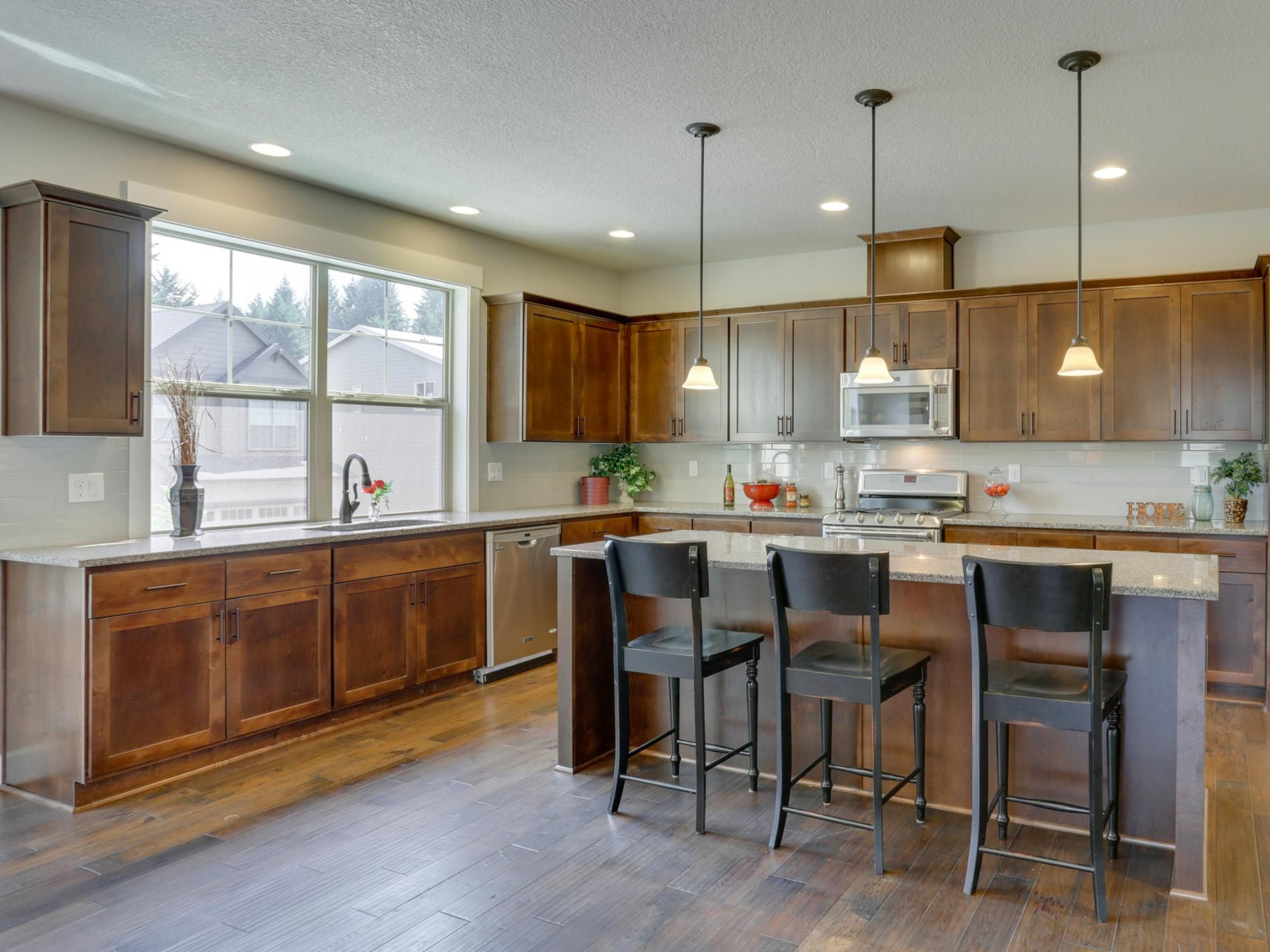 Kitchen with shaker style maple cabinetry, quartz ... on Maple Kitchen Cabinets With Quartz Countertops  id=33851