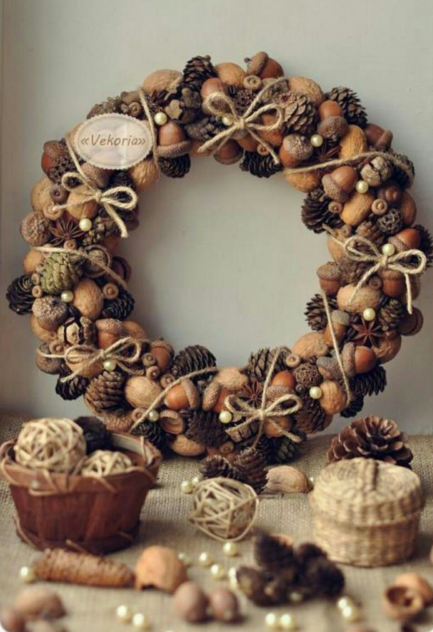 I have to make one I love all the texture this nature wreath creates with the acorn and pine cones so pretty