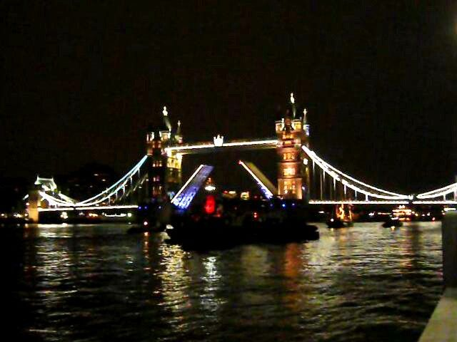 The tug and barge symphony at Tower Bridge, London