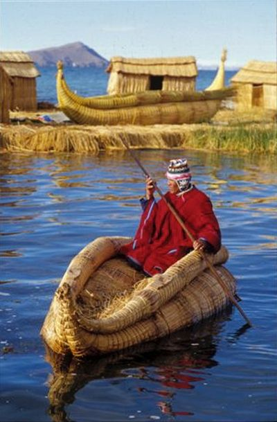 Peruvian Balsa Reed Boat going to his home on Urus-- The floating Reed Island on Lake Titicaca.