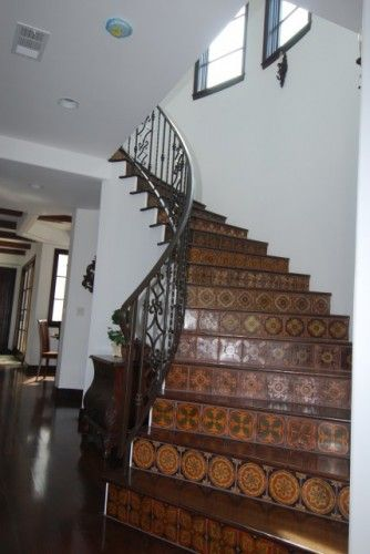 Beau Ceramic Stairs, White Walls And Dark Floors