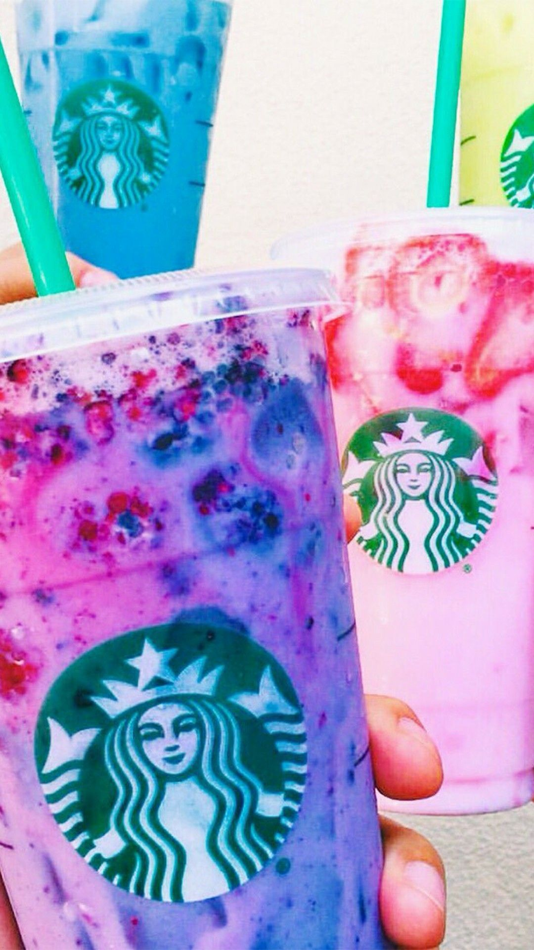 Purple, pink, and blue Starbucks drink  Also a little yellow  | YUM