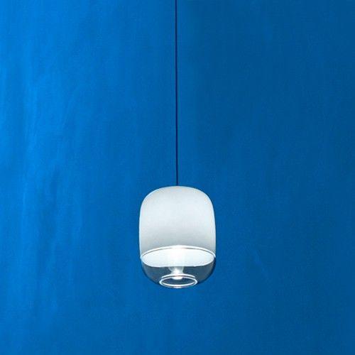 Silver pendant lights over bedside tables