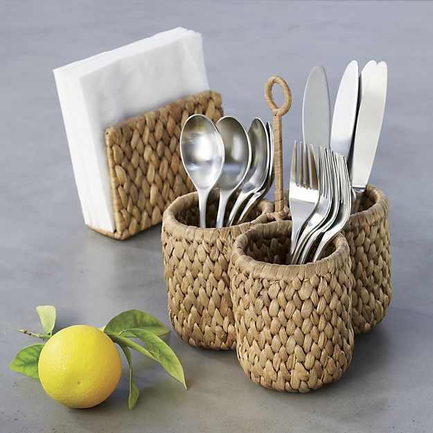 Sustainable, eco-friendly and appealingly rustic hyacinth fiber knits up as a three-round caddy, equipped with a looped handle for easy transport of flatware or condiments.
