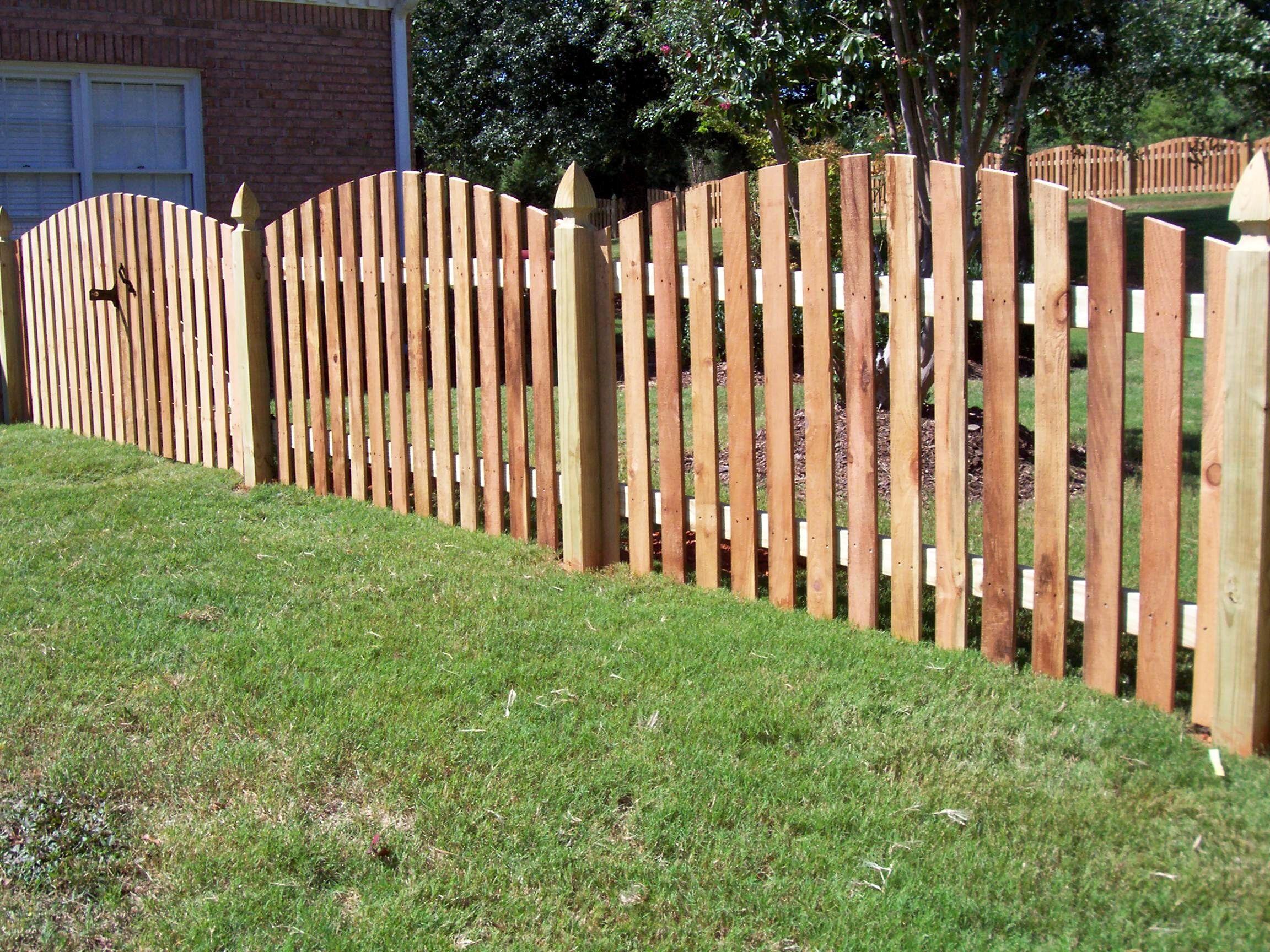 Custom scallop cut wood picket fence design mossy oak fence custom scallop cut wood picket fence design mossy oak fence company orlando melbourne baanklon Choice Image