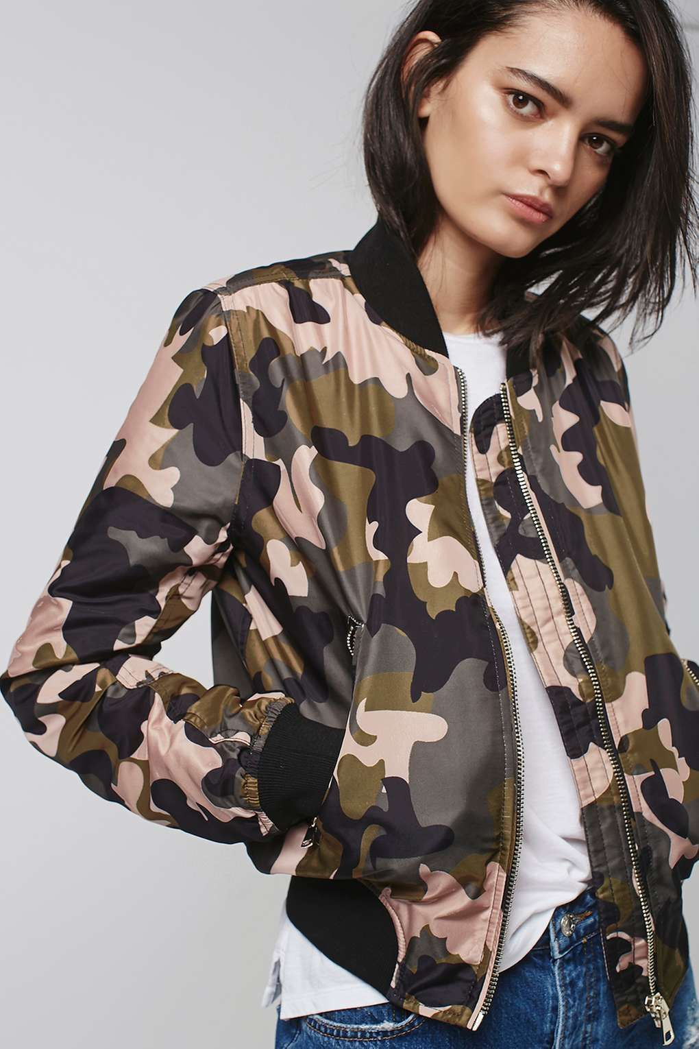 b3c441a8 Take the utilitarian look to the next level with the camouflage print bomber  jacket. Complete with authentic MA1 details, ribbed trims and contrasting  pink ...