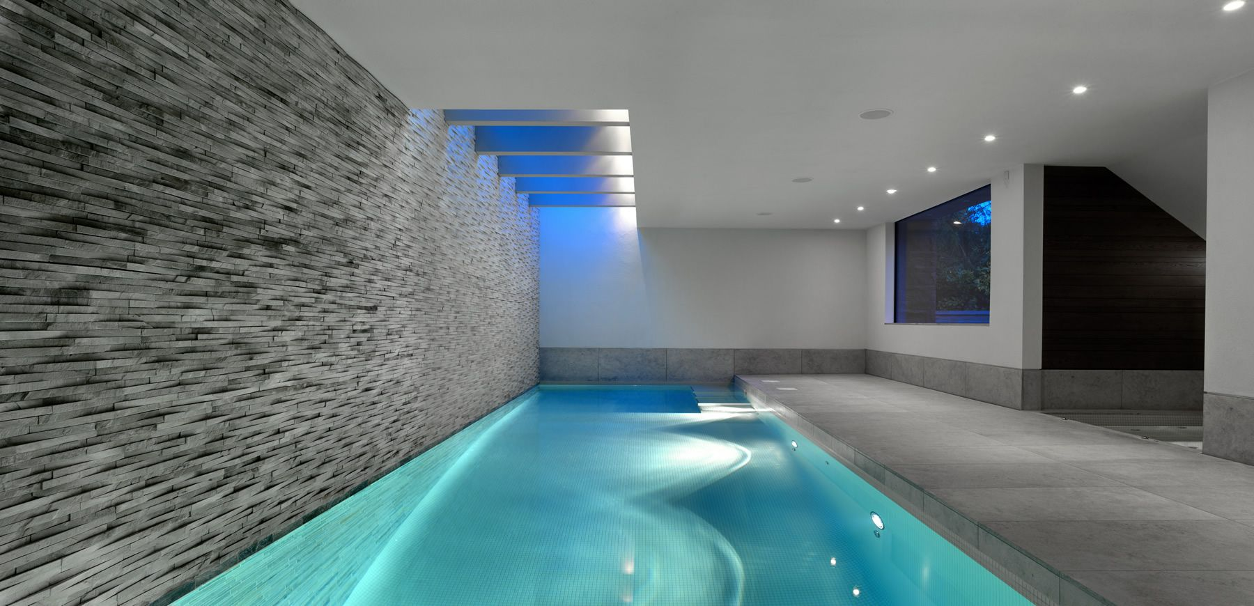Divine apartments stylish and cool indoor swimming pool for Domestic swimming pool design