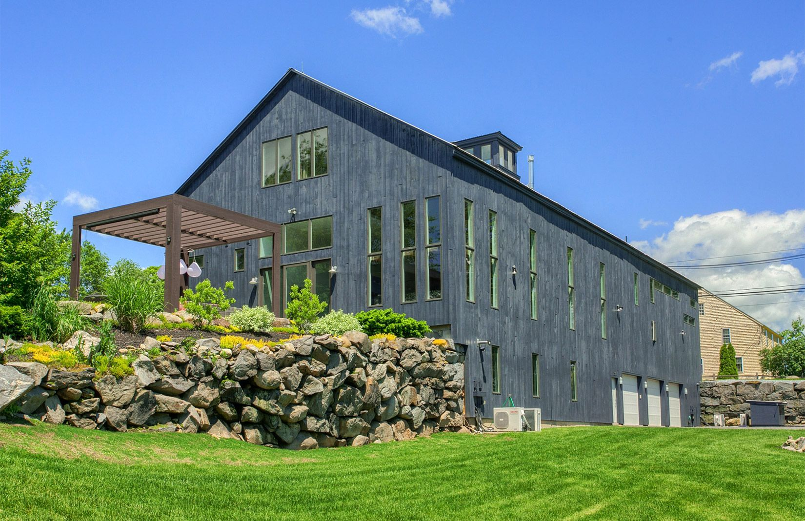 Converted dairy farm near Boston hits the market for
