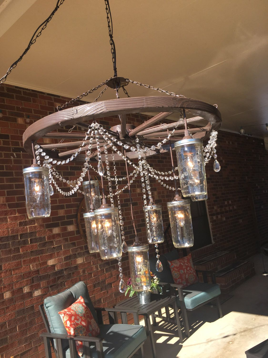 Large wagon wheel chandelier with 3 tiers of mason jars by large wagon wheel chandelier with 3 tiers of mason jars by southerncharmbykaren on etsy https arubaitofo Choice Image