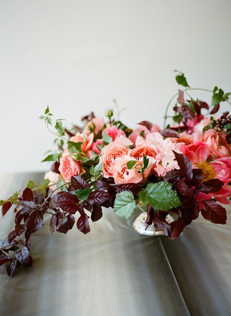 Plum foliage, romantic Antik and Chippendale roses, Coral Charm peonies, sweet peas, clematis foliage, and rhubus