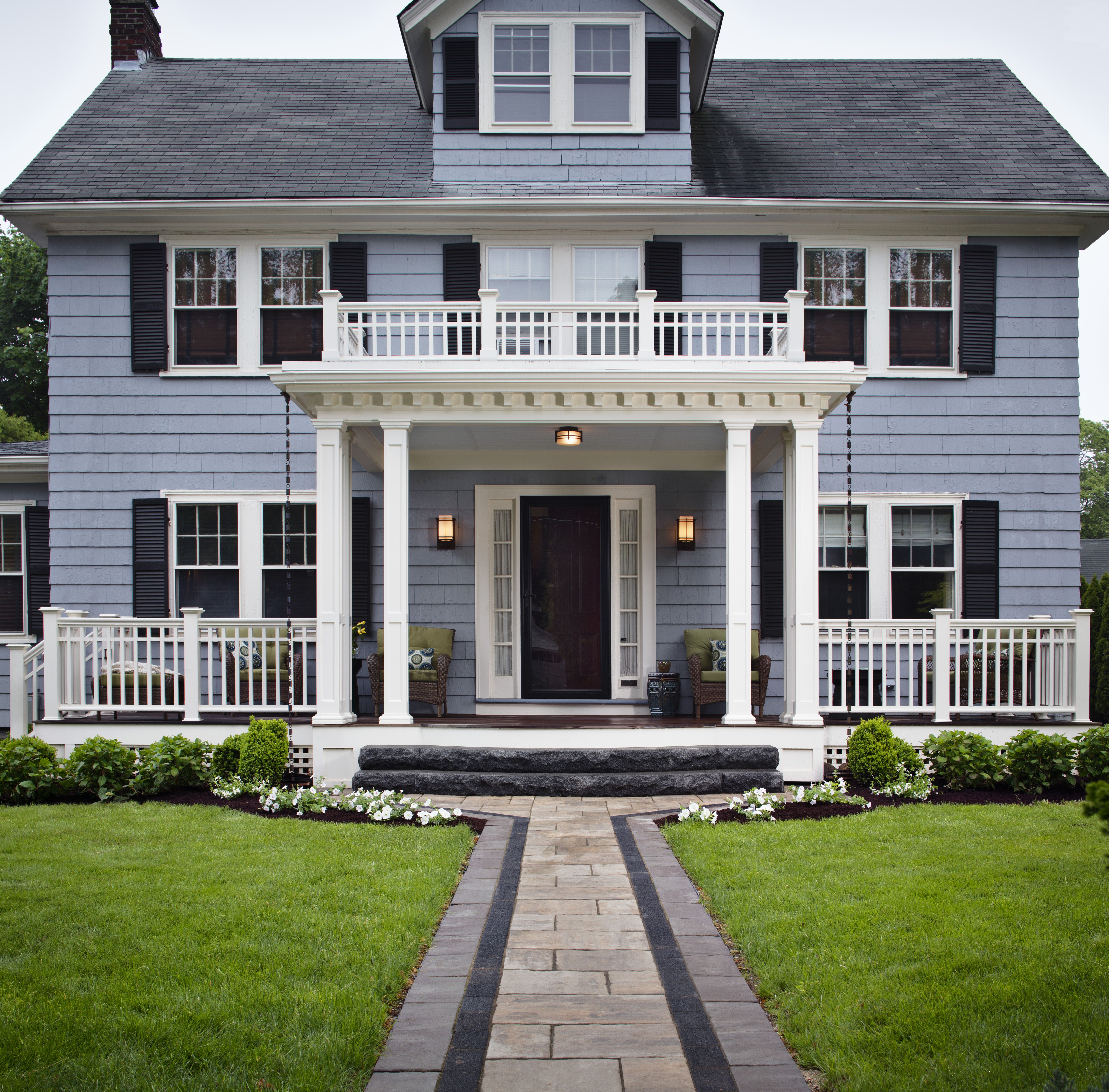 This spectacular front porch entryway, including a balcony ...