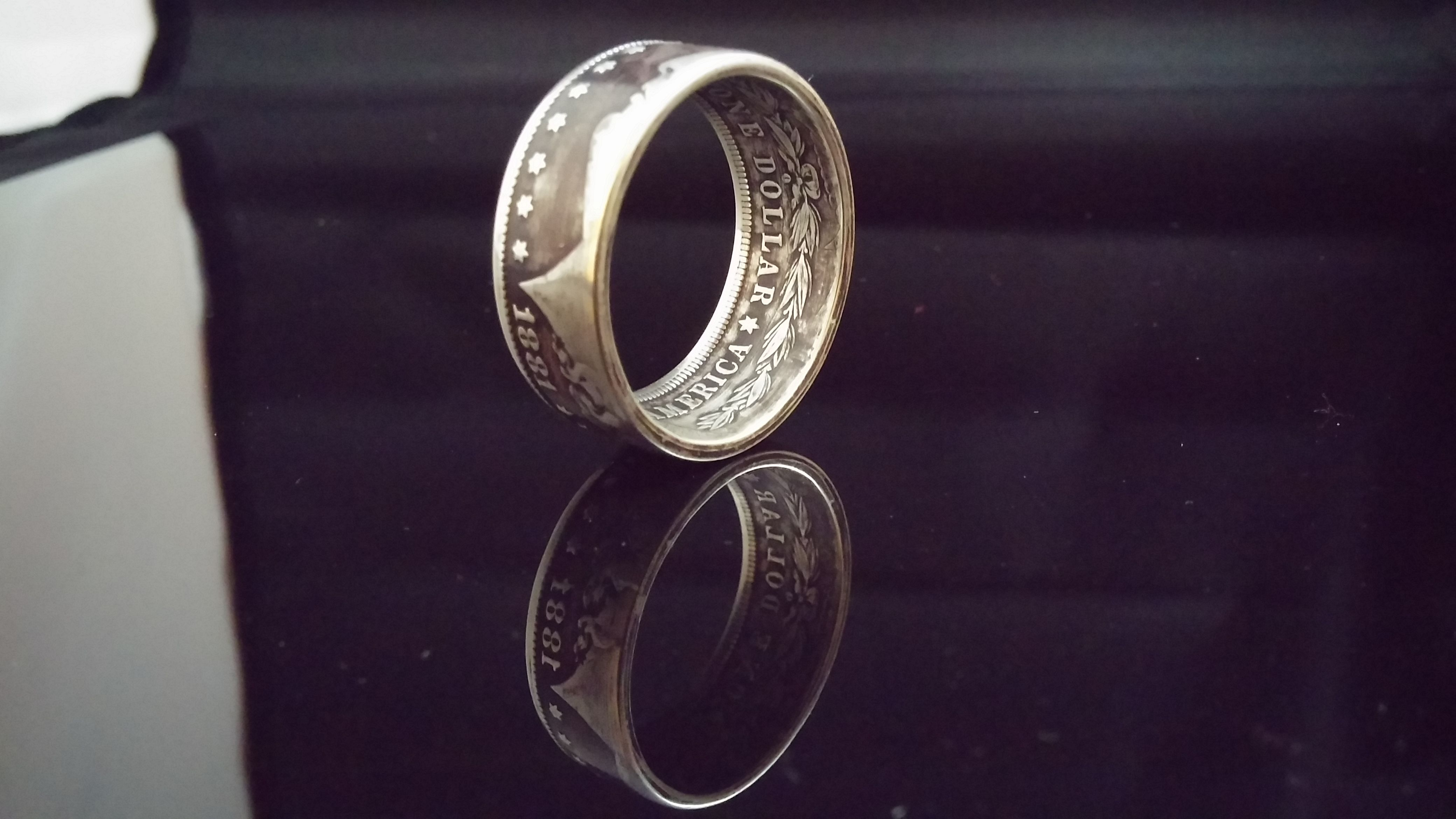 1881 Morgan Silver Dollar Ring size 15.  http://thetwistedcoin.etsy.com
