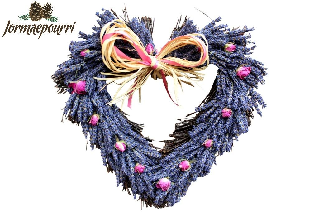 Twig heart shaped base, Provence lavender and dried pink rosebuds. All finished with raffia/ribbon bow and scented with 'Lavender Fields' oil. looks amazing in every bedroom or living room.