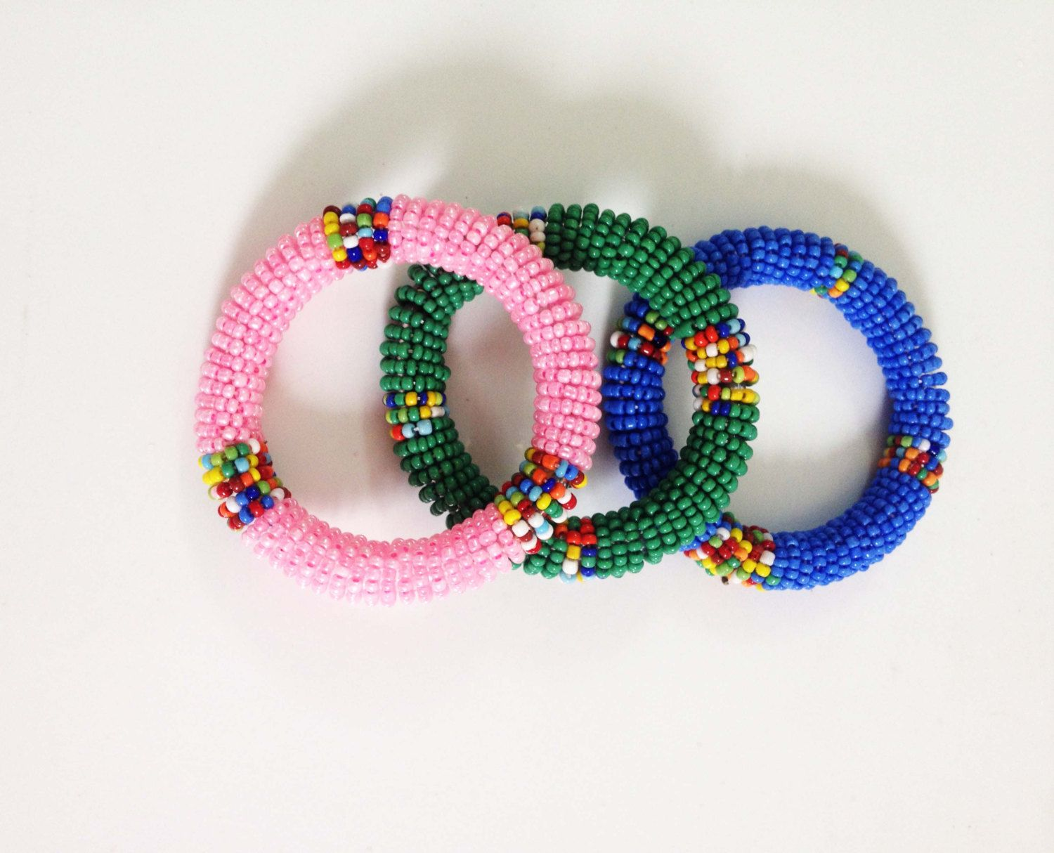 A set of Pink, Green and Blue Beaded, Roll-up African Bracelets for Kids by SipsHouseofDesign on Etsy