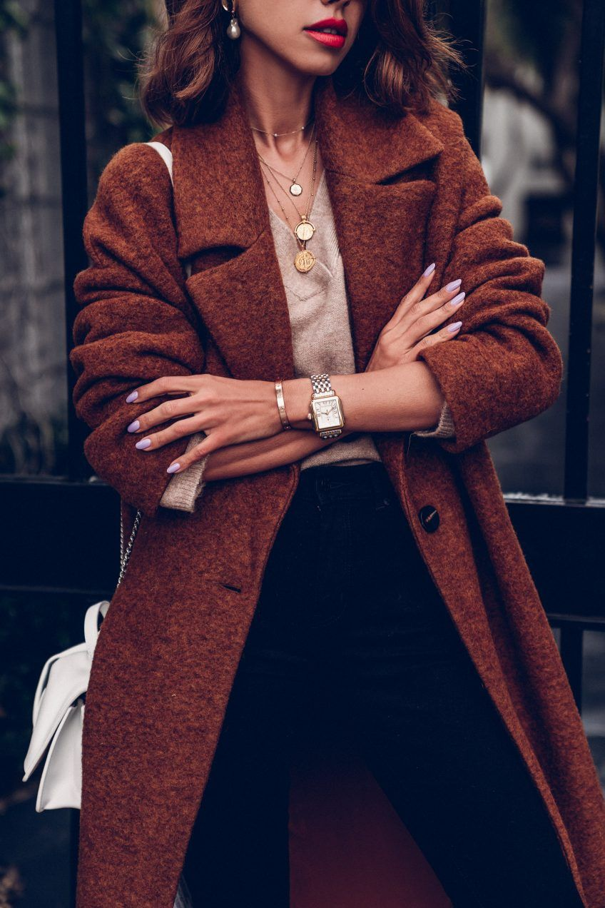 Can't be more obsessed with this Mango coat than I am - such a perfect fall / winter staple. Keeping me warm in this cold LA winter - layered a V neck sweater underneath and paired it with black skinny jeans and a white bow No 21 bag. Red lips for a pop of color! #falloutfit #winteroutfit #outfit #coat #fashion #style #mango #outfitidea #stylingtips #redlips #redlipstick