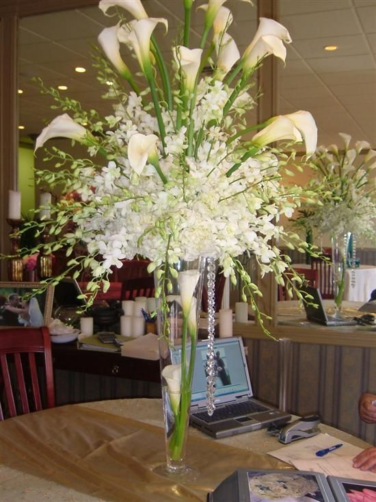 Calla lillie and orchid centerpiece lilies or