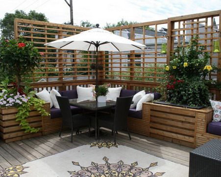 outdoor patio design ideas with seat sets in the corner decorated with flowers - Outdoor Patio Design Ideas